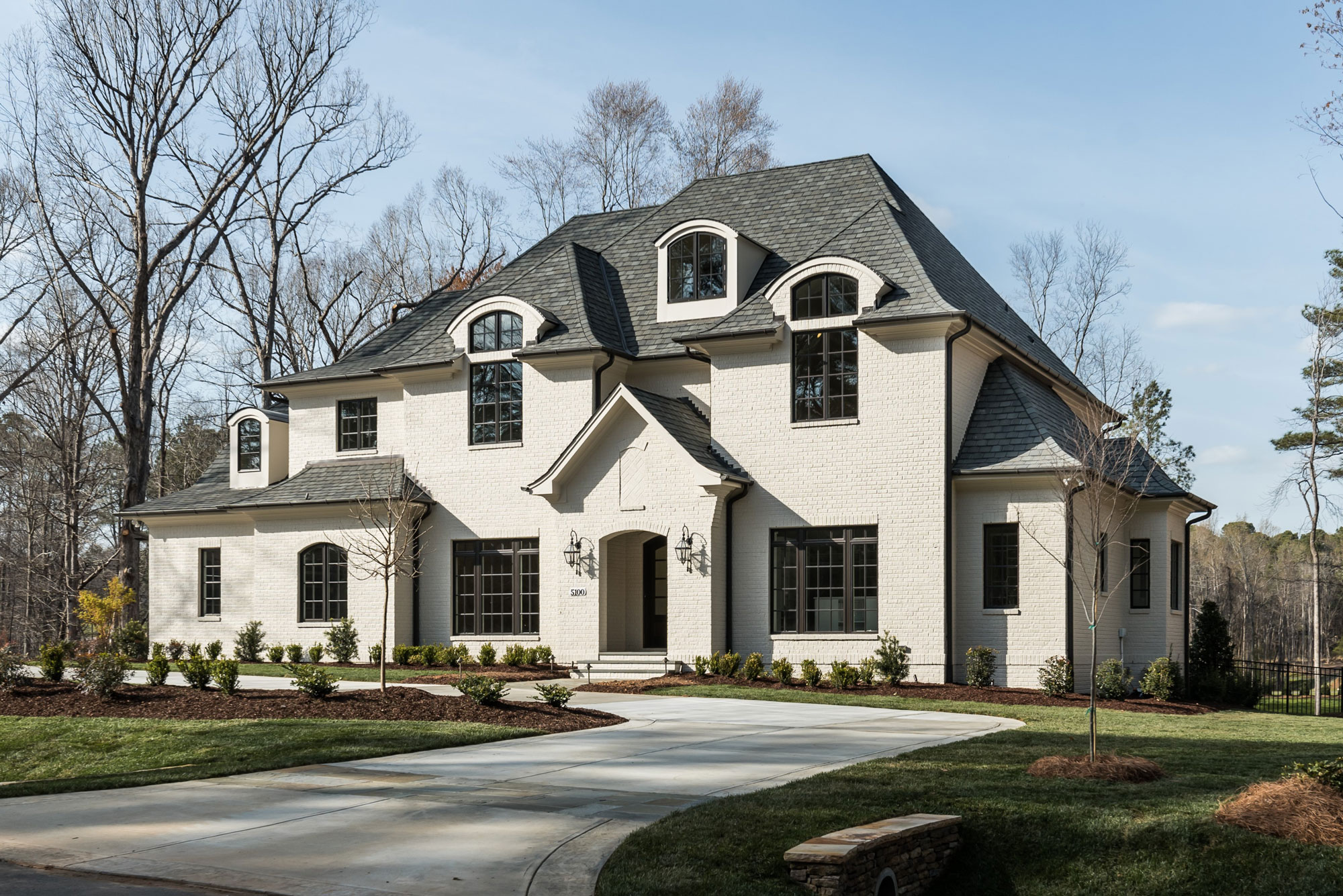 Exterior of home by Luxury Real Estate Developer